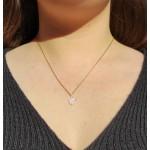 Colgante en forma corazon con piedra transparente en Oro 18kt
